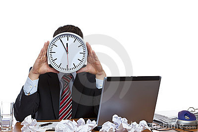 Mann under time pressure with clock at face
