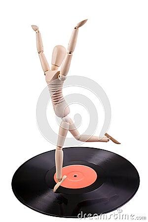 Mannequin dancing on vinyl disc