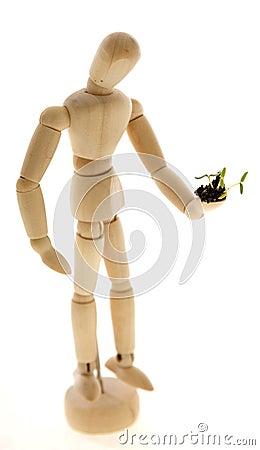 Mannequin Holding Plant Seedling