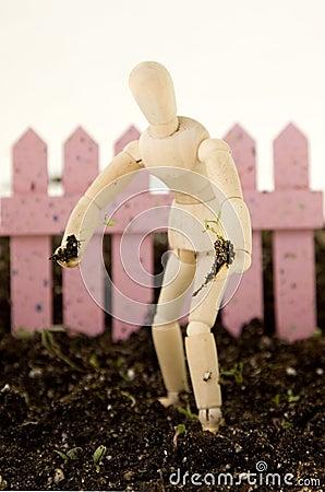 Mannequin Planting Seedling Standing in Soil