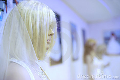 Mannequin in a wedding dress and wig