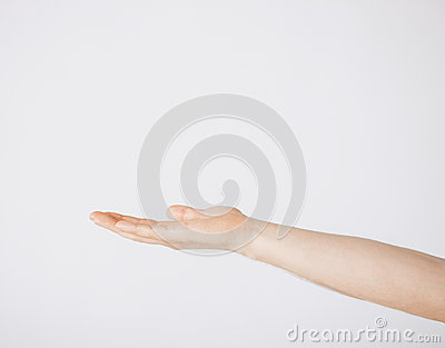 Mans hand showing something