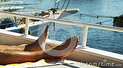 Mans legs on yacht