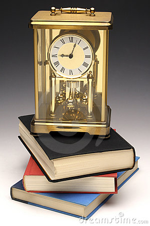 Mantle Clock On Books Royalty Free Stock Photo - Image: 7794725