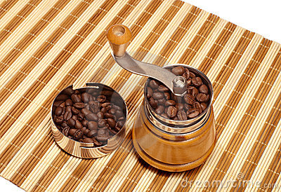 Manual coffee grinder on a bamboo napkin