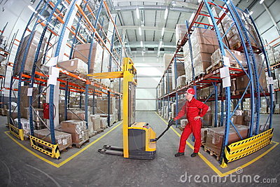 Manual Forklift Operator At Work In Warehouse Stock Image - Image ...