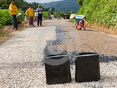 Manual road construction work in Burma Editorial Stock Image