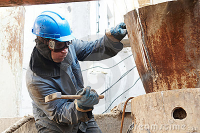 Manual worker in action with hammer