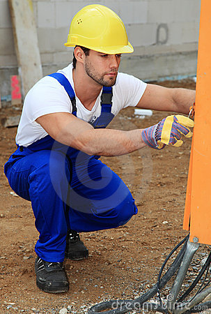 Manual worker checking power supply