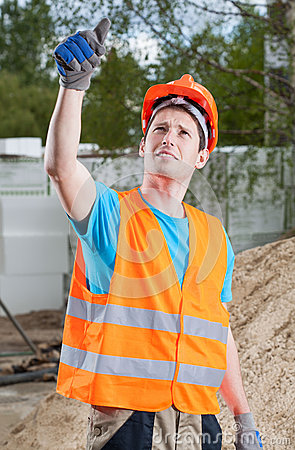 Manual worker showing thumbs up sign