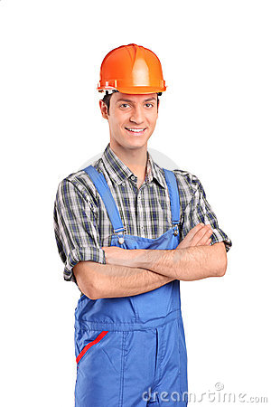 Manual worker wearing blue overall and helmet