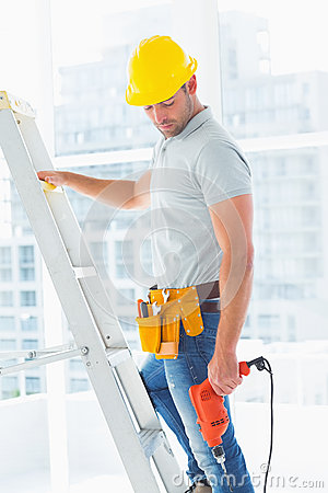 Free Manual Worker With Drill Machine Climbing Ladder Royalty Free Stock Image - 50478676