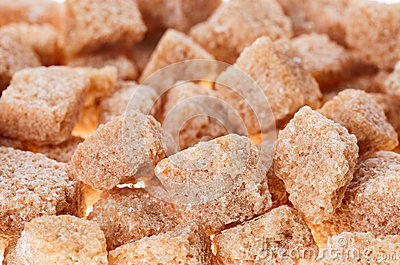 Many brown lump cane sugar cubes