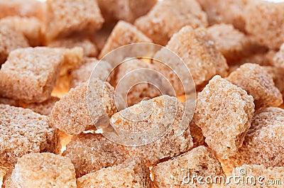 Many brown lump cane sugar cubes