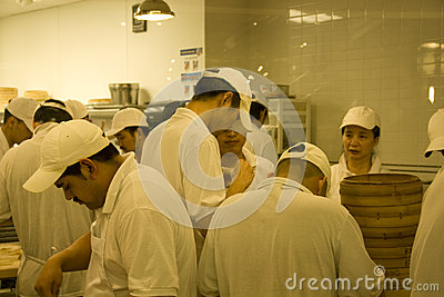 Busy chefs in chinese restaurant kitchen Editorial Stock Image