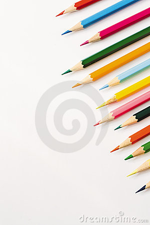 Many colour pencils isolated on white