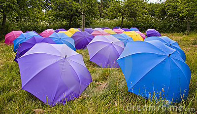 Many coloured open umbrellas
