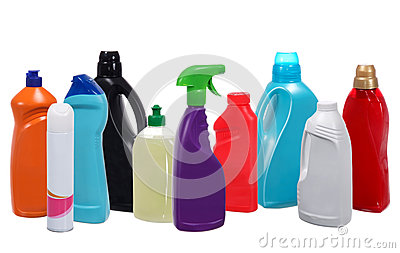Many different plastic bottles of cleaning products