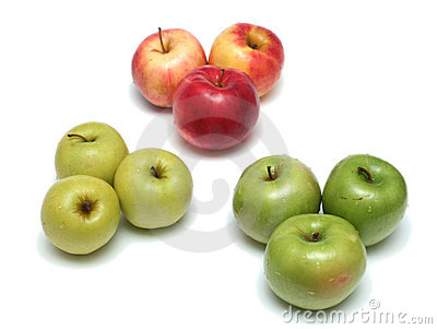 Many different ripe tasty apples on a white backgr