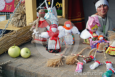 Many handmade dolls on the table. Editorial Photo