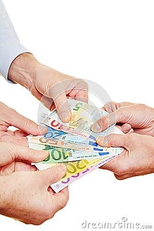 Many hands pulling on Euro money