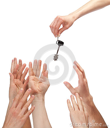 Many hands reaching out for key