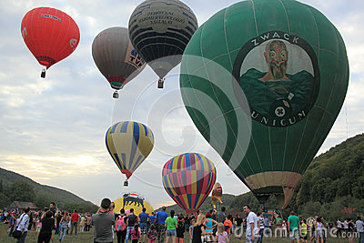 Many hot air balloons lifting off ground Editorial Photo