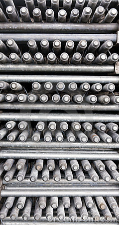 Many layers of machine bolts vertical