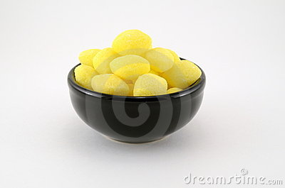 Many Lemon Drops in Black Bowl