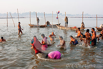 Many men and women bathe in holy river Editorial Image