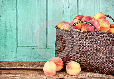 Many peaches in basket