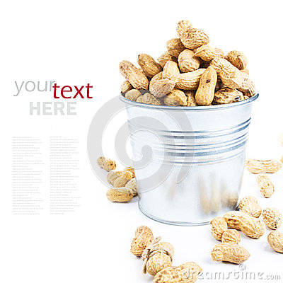 Many peanuts in shells in a metal bucket closeup  (with easy rem