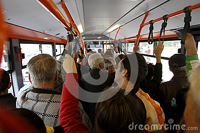 Many people in overcrowded bus Editorial Photo