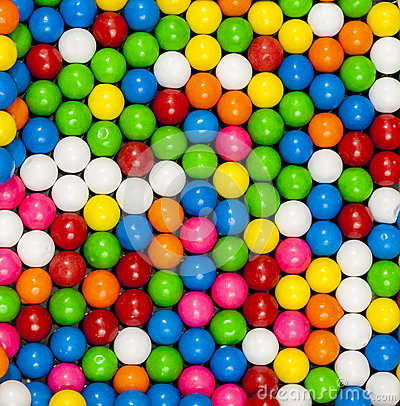 Colorful gumballs arranged in a patter