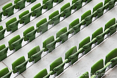 Many rows of seats in big empty stadium