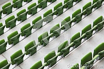 Many rows of seats in big empty stadium