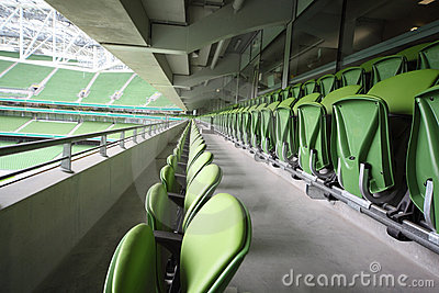 Many rows of seats in empty stadium Editorial Photo