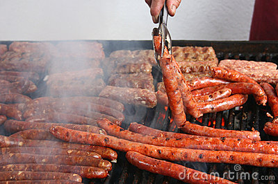 Many sausages on grill