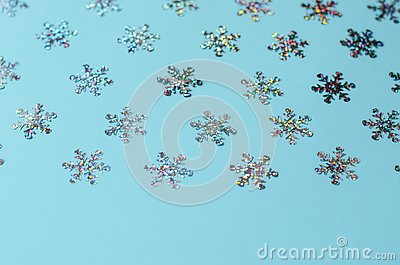 Many shimmering snowflakes on a blue background. Stock Photo