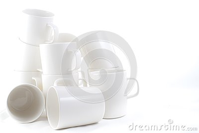 Many stacked of white cups