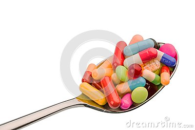 Many tablets on spoon