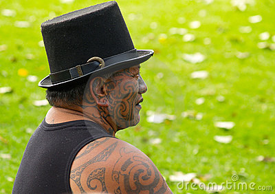Maori man displaying traditional  facial tattoo. Editorial Stock Image