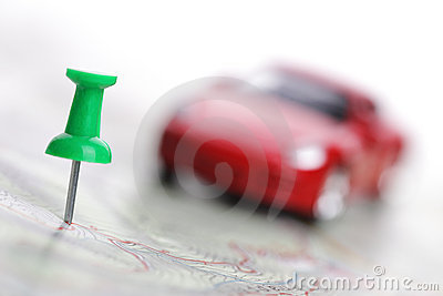 Map with push pin and car