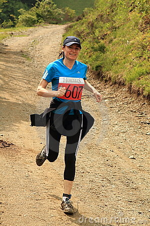 Marathon female runner in the mountains Editorial Stock Image
