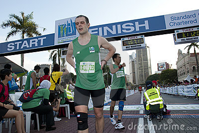 Marathon Runner on the finish Line Editorial Photo