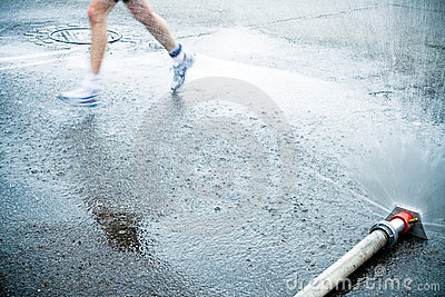 Marathon runner on wet city street