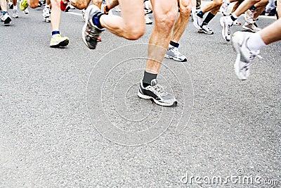 Marathon runners, motion blur on running shoes