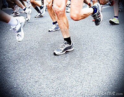 Marathon runners, running shoes motion blur