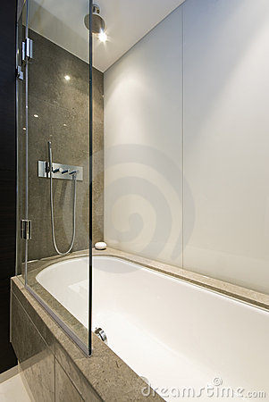 Marble Bath Tub With Slim Line Shower Attachment Stock Photos - Image: 12239353