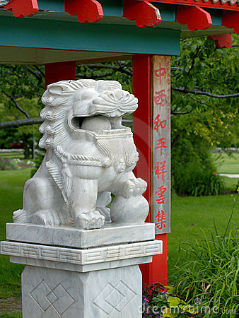 Marble lion amidst Chinese-style architecture (I)